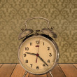 Retro clock on vintage wallpaper — Stock Photo