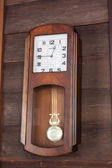 Old wood clock hang on wood wall — Stock Photo