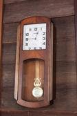 Old wood clock hang on wood wall — Stock Photo