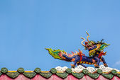 Dragon horse statue on the roof in chinese temple, pakchong, Tha — Stock Photo