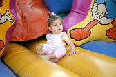 Child playing on a inflatable castle — Stock Photo