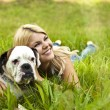 Girl with a dog on the grass — Stock Photo #6211334