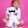 Portrait of a red-haired girl in a white sweater with a soft toy — Stock Photo #8221099