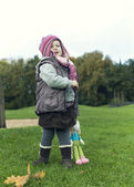 Little girl in warm autumn clothing — Stock Photo