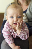 Beautiful inquisitive little baby girl — Stock Photo