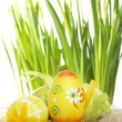 Pretty painted Easter Eggs on hessian - Stock Photo