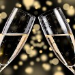Stock Photo: Champagne glasses on bokeh background