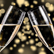 Champagne glasses on bokeh background - Stock Photo