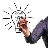 Main dessin ampoule - bonne idée concept — Photo