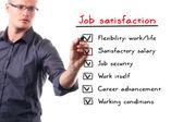 Adam beyaz tahta üzerinde iş memnuniyeti liste yazma — Stok fotoğraf