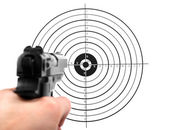 Hand with gun shooting target — Stok fotoğraf