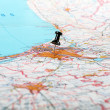 Pushpin showing the location of a destination point on a map — Stock Photo #16301305
