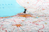 Pushpin showing the location of a destination point on a map — Stock Photo