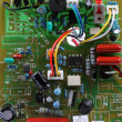Circuit board with electrical components and wires - Stock Photo