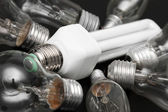 Energy efficient bulb in the middle of old incandescent — Stock Photo
