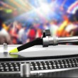 Dj turntable with vinyl record in the dance club — Stock Photo #21507943