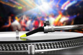 Dj turntable with vinyl record in the dance club — Stock Photo