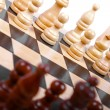 Wooden chess pieces on the board — Foto de Stock