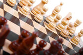 Wooden chess pieces on the board — Stock Photo