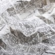 Background of old crumpled newspaper - Stock Photo