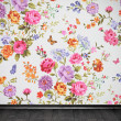 Стоковое фото: Vintage room with floral colorful wallpaper and wooden floor