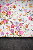Vintage room with floral colorful wallpaper and wooden floor — Stock Photo