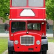 Stock Photo: Big red double decker bus on street