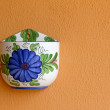 Colorful empty flower pot on orange wall — Stok fotoğraf