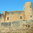 Ancient medieval castle against blue sky in Mallorca — Stock Photo