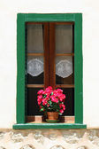 Window with flower pot on the building wall — Stock Photo