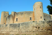Ancient medieval castle against blue sky in Mallorca — Stok fotoğraf