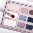 Palette with eye shadows and makeup brush — Foto Stock