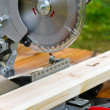 Portable circular saw and wood plank — Stock Photo