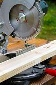 Portable circular saw and wood plank — Stock Photo