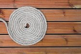 Rope on wooden yacht deck — Stock Photo