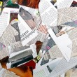 Background with variety of different torn newspapers and magazines — Stock Photo