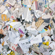 Background with different torn newspapers and magazines — Stock Photo #30429379