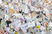 Background with different torn newspapers and magazines — Stock Photo