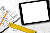 Blank tablet and tools on house project blueprints — Stock Photo