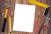 Blank page with work tools on wooden background — Stock Photo
