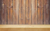 Empty shelf on brown wooden plank wall — Stock Photo