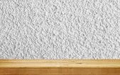Empty shelf on white plaster wall — Stock Photo