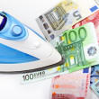 Ironing euro money — Stock Photo