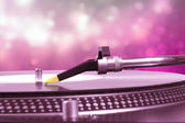 Dj turntable with pink bokeh background — Stock Photo