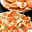 Stock Photo: Various delicious appetizers with cheese salmon and tomato