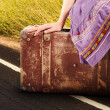 Stock Photo: Woman with old vintage suitcase on the road