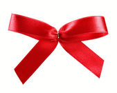 Red satin ribbon gift bow isolated on white — Stock Photo