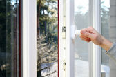 Hand open plastic pvc window — Stock Photo
