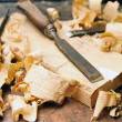 Stock Photo: Old wood chisels with shavings on workbench