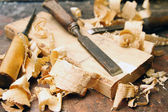 Old wood chisels with shavings on the workbench — Stock Photo